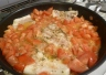 Cod with tomatoes in the pan