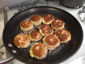 Fish cakes cooking in the pan