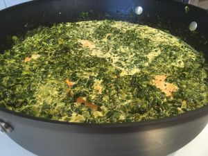 Salmon with creamy spinach in preparation